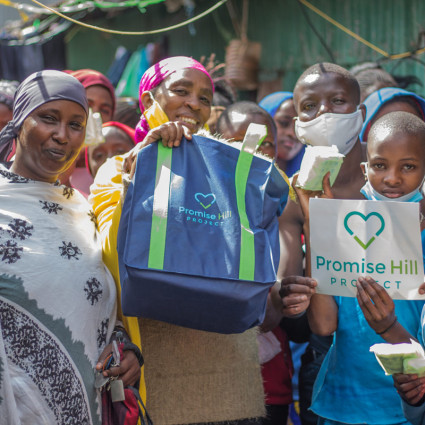 Slum-12.great-smiles-show-gratitude-and-excellent-brand-placement-for-Promise-Hill